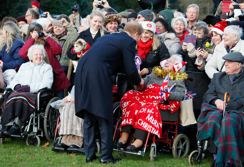 . Britain\'s Prince Harry speaks with members of the public, as he leaves after attending a Christmas day church service in Sandringham, England, Sunday, Dec. 25, 2016. A heavy cold is keeping Queen Elizabeth II from attending the traditional Christmas morning church service near her Sandringham estate. (AP Photo/Kirsty Wigglesworth)