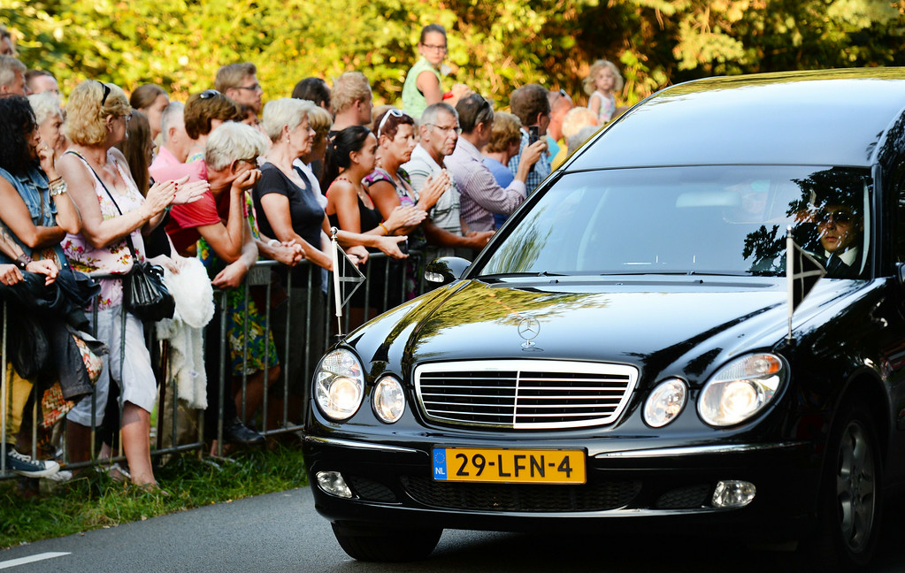 . A convoy of funeral hearses drives on July 24, 2014 at the Korporaal van Oudheusdenkazerne in Hilversum, where the bodies of the in total 298 victims of the Malaysia Airlines MH17 plane crash in eastern Ukraine arrive from Kharkiv, Ukraine, will be examined. A Dutch Air Force C-130 Hercules plane and an Australian Royal Australian Air Force C17 transported the remains. Dozens more bodies from the crash site of Malaysia Airlines flight MH17 are set to arrive in the Netherlands on July 24, as the EU prepares to hit Russia with fresh sanctions. AFP PHOTO / ANP / REMKO DE WAAL   AFP PHOTO ANP PIROSCHKA VAN DE WOUW   -/AFP/Getty Images