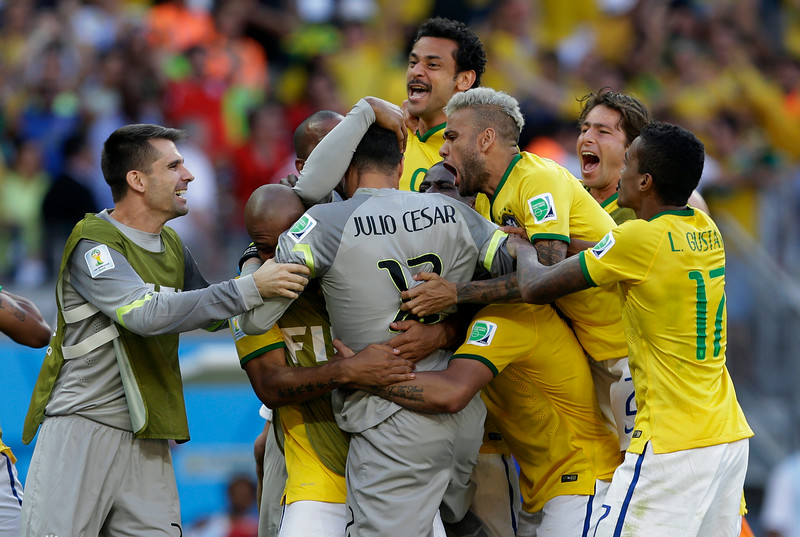 . Brazilian players react after a penalty shoot out at the end of the World Cup round of 16 soccer match between Brazil and Chile at the Mineirao Stadium in Belo Horizonte, Brazil, Saturday, June 28, 2014. Brazil won the match 3-2 on penalties after the match ended 1-1. (AP Photo/Andre Penner)