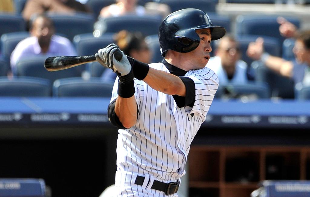 . New York\'s Ichiro Suzuki hits a solo home run off  Twins relief pitcher Caleb Thielbar in the seventh inning. (AP Photo/Kathy Kmonicek)