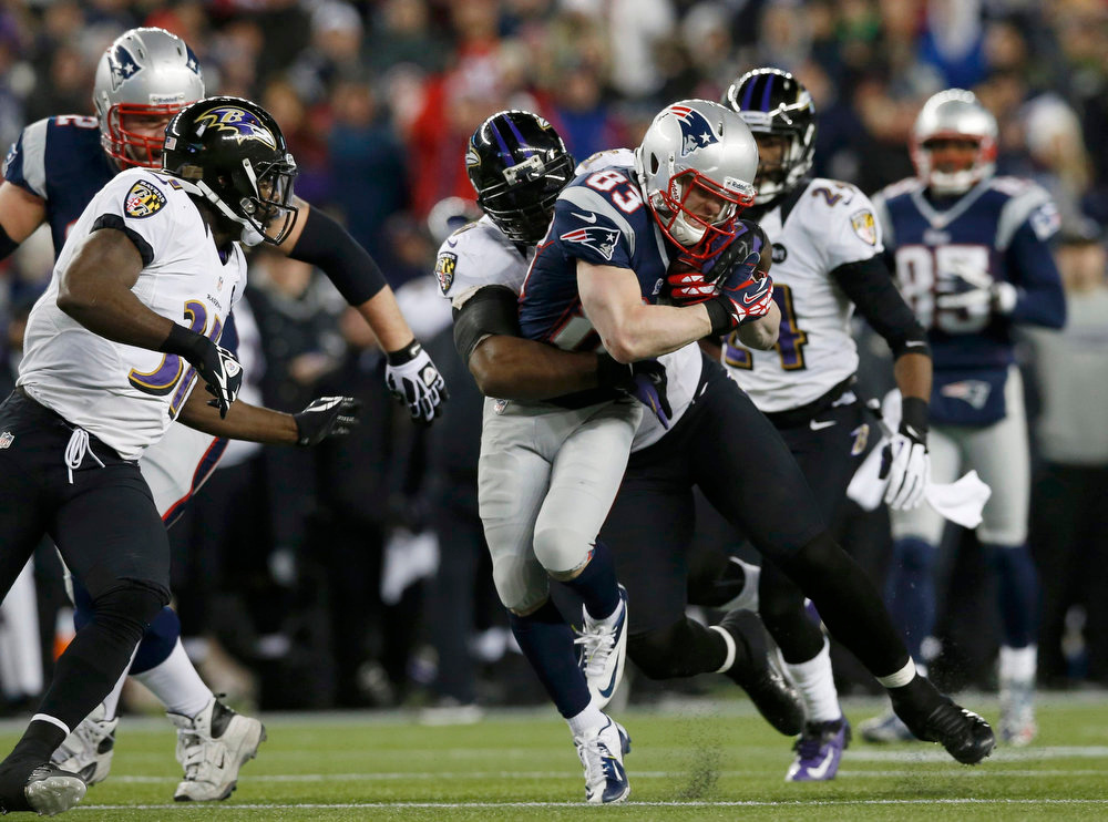 Description of . Baltimore Ravens outside linebacker Terrell Suggs (55) works to stop New England Patriots wide receiver Wes Welker (83) in the first half of the NFL AFC Championship football game in Foxborough, Massachusetts, January 20, 2013. REUTERS/Mike Segar