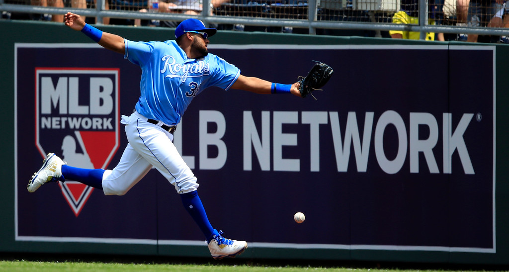 . Kansas City Royals right fielder Jorge Bonifacio tries for and misses a foul ball hit by Cleveland Indians\' Austin Jackson during the fifth inning of a baseball game at Kauffman Stadium in Kansas City, Mo., Saturday, June 3, 2017. (AP Photo/Orlin Wagner)