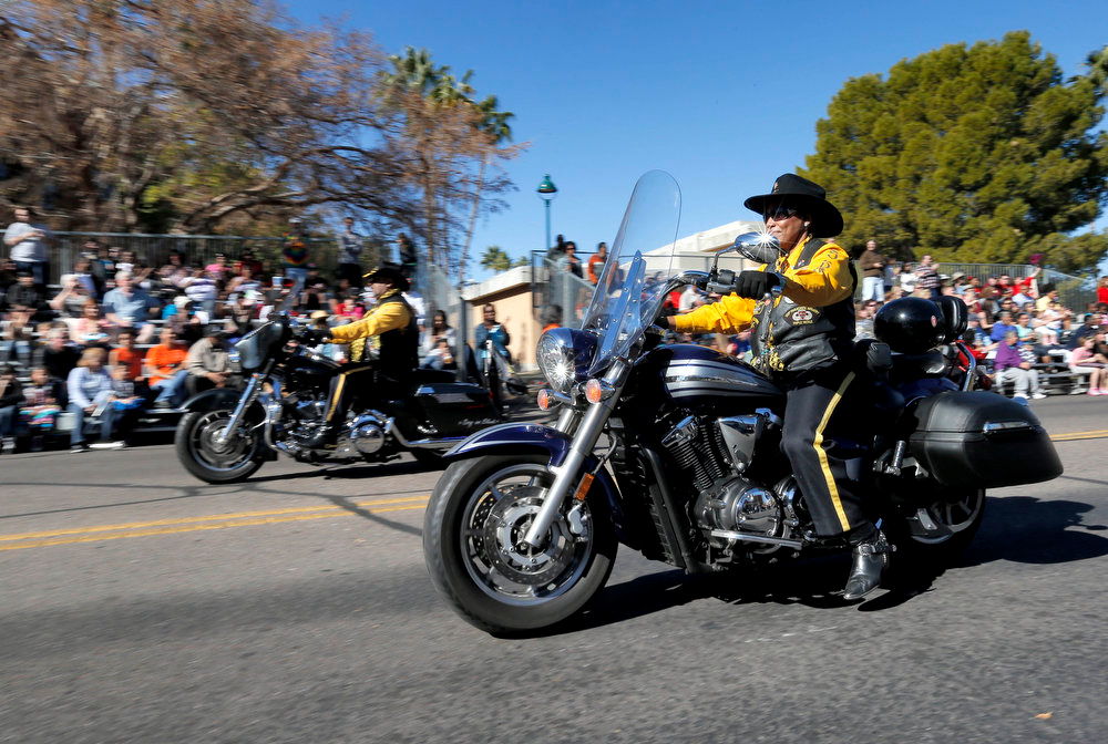Description of . Buffalo Soilders of America ride during the MLK day parade, Monday, Jan. 21, 2013 in Mesa, Ariz. The nation honored civil rights leader Martin Luther King Jr. on Monday. (AP Photo/Matt York)