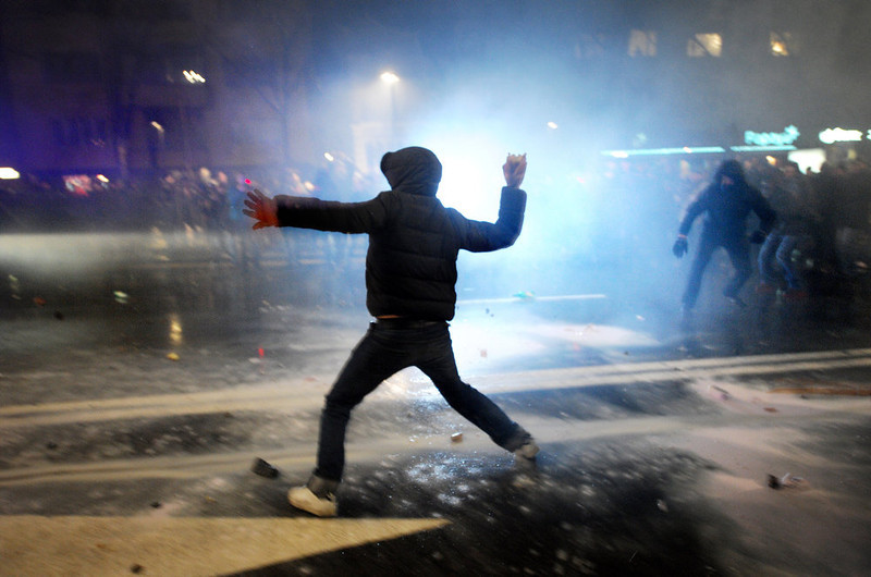 . A demonstrator throws a rock to riot police during clashes on the sidelines of a protest against the government in downtown Sofia on February 19, 2013. Bulgaria has been shaken over the past week by protests that initially were about soaring electricity prices but which have turned into demonstrations against the government in general.     NIKOLAY DOYCHINOV/AFP/Getty Images