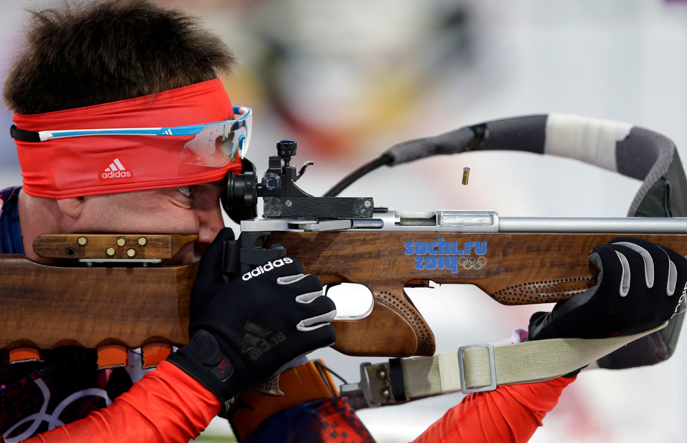 . Russia\'s Yevgeny Garanichev shoots during the men\'s biathlon 20k individual race, at the 2014 Winter Olympics, Thursday, Feb. 13, 2014, in Krasnaya Polyana, Russia. (AP Photo/Lee Jin-man)