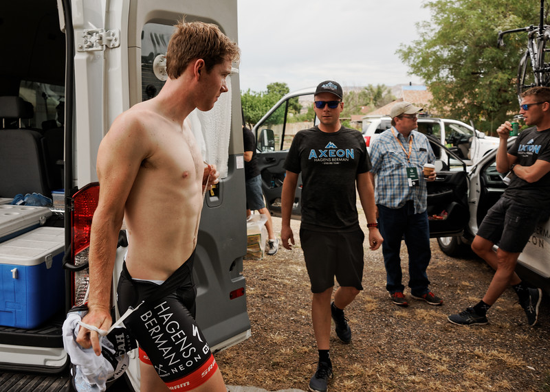 """Colin Joyce suits up for Stage 2, Larry H. Miller @TheTourofUtah, Escalante, Utah.  """"I think at that moment he was rushing off for an interview with Fox Sports"""" Davey Wilson recalls, """"And if you look his right hand, he's holding the white jersey got after finishing 2nd in Stage 1 the day before."""" #PROVEIT #tourofutah   (📷: Copyright © @DaveyWilson)"""