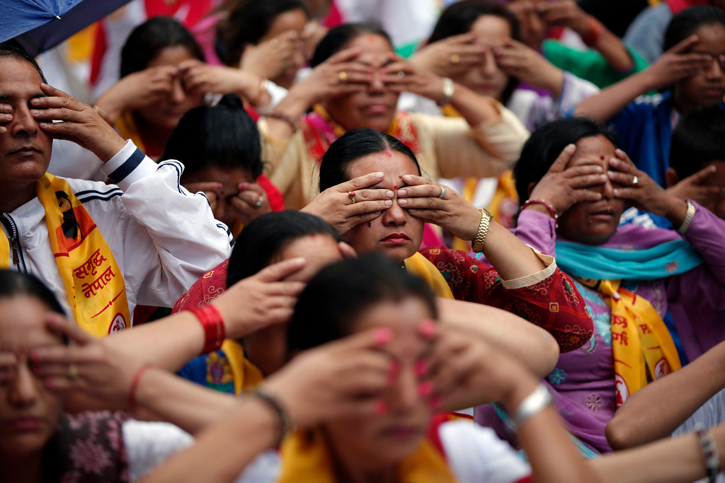 . Nepalese women perform Yoga during International Yoga day in Kathmandu, Nepal, Wednesday, June 21, 2017. International Yoga Day is celebrated every year on June 21 through out the world. (AP Photo/Niranjan Shrestha)
