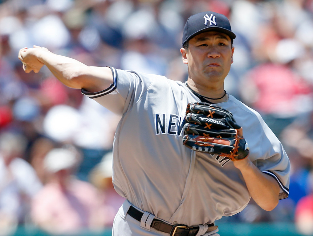 . New York Yankees starting pitcher Masahiro Tanaka throws to first base while attempting to pick off Cleveland Indians\' Michael Brantley during the fourth inning of a baseball game, Sunday, July 15, 2018, in Cleveland. (AP Photo/Ron Schwane)