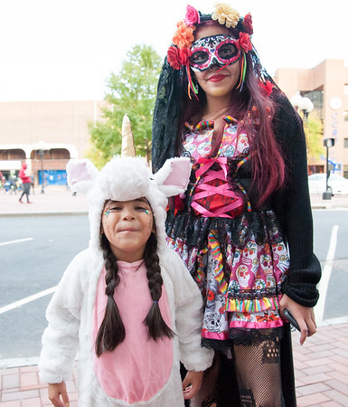10/31/18 Wesley Bunnell | Staff Alana Olivero, age 6, poses with her mother Alba Olivero during New Britain's annual Halloween Safe Zone event at Central Park on Halloween night.