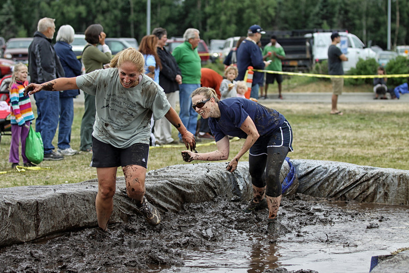 TJ Strawn and Jackie Seiffert having fun in the mud..