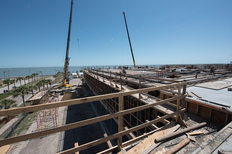 Construction crews remove the frames from the second floor as they prepare to pour concrete on the third floor of Tidal Hall.
