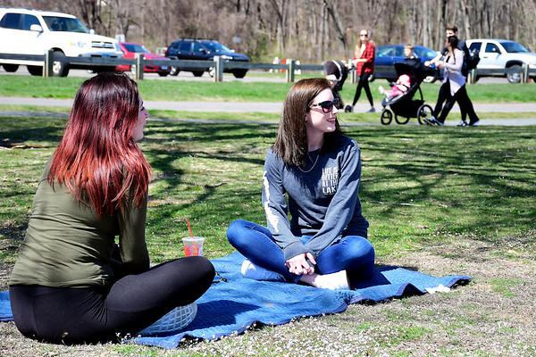 4/7/2020 Mike Orazzi | Staff Sisters Alyssa Lumbra and Kayla Martin while spending some time in Plainville's Norton Park on Tuesday.