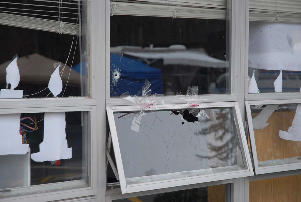 . In this handout crime scene evidence photo provided by the Connecticut State Police, shows a damaged window at the Sandy Hook Elementary School following the December 14, 2012 shooting rampage, taken on an unspecified date in Newtown, Connecticut. A second report was released December 27, 2013 by Connecticut State Attorney Stephen Sedensky III gave more details of the the Newtown school shooting that left 20 children and six women educators dead inside Sandy Hook Elementary School. (Photo by Connecticut State Police via Getty Images)