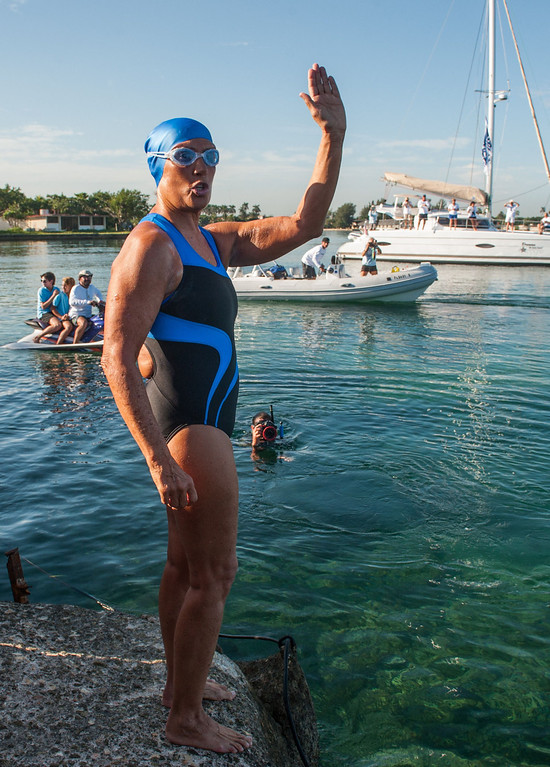 . US swimmer Diana Nyad waves before attempting to swim in a three-day non-stop journey from Havana to Florida at the Ernest Hemingway Nautical Club, in Havana on August 31, 2013.   YAMIL LAGE/AFP/Getty Images