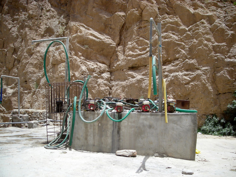 a shared water well with truck refilling set-up in Wadi Tiwi