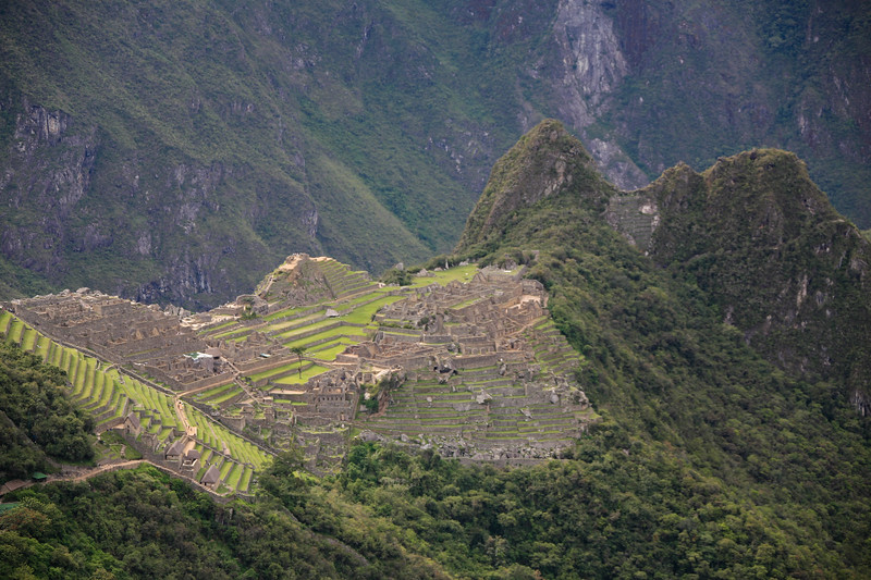 Long view of Machu Picchu and Huayna Picchu (Wayna Picchu) on a cloudy day from near the Sun Gate.