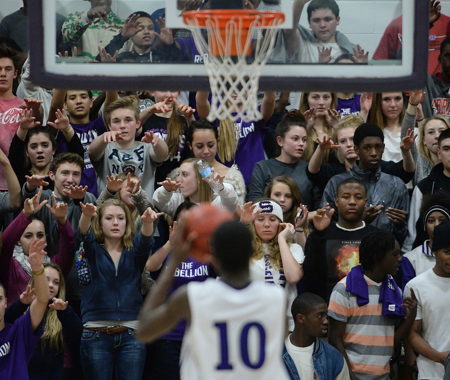 . Denver South fans watched as center Ibrahim Sylla sank a free throw in the third quarter. Photo By Karl Gehring/The Denver Post