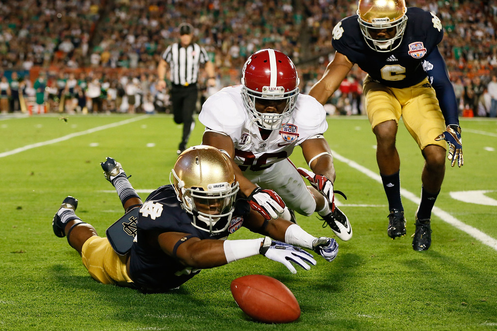 . MIAMI GARDENS, FL - JANUARY 07:  Davonte\' Neal #19 of the Notre Dame Fighting Irish fights for a loose ball after muffing the punt against Landon Collins #26 of the Alabama Crimson Tide in the second quarter against the Alabama Crimson Tide during the 2013 Discover BCS National Championship game at Sun Life Stadium on January 7, 2013 in Miami Gardens, Florida.  (Photo by Kevin C. Cox/Getty Images)