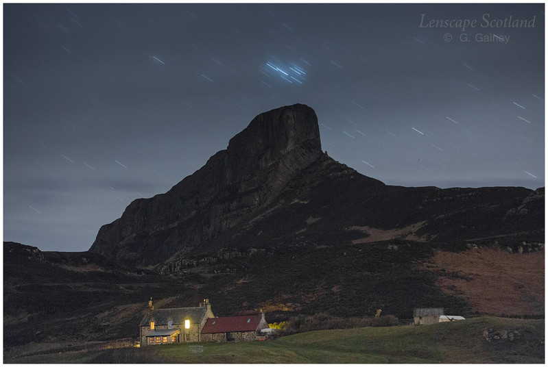 Galmisdale farmhouse and An Sgurr at night