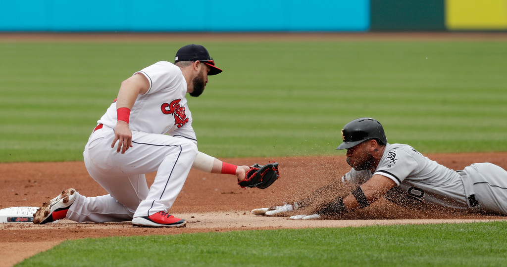 . Cleveland Indians\' Jason Kipnis, left, tags out Chicago White Sox\'s Yoan Moncada as Moncada tried to steal to second base in the first inning of a baseball game, Wednesday, May 30, 2018, in Cleveland. (AP Photo/Tony Dejak)