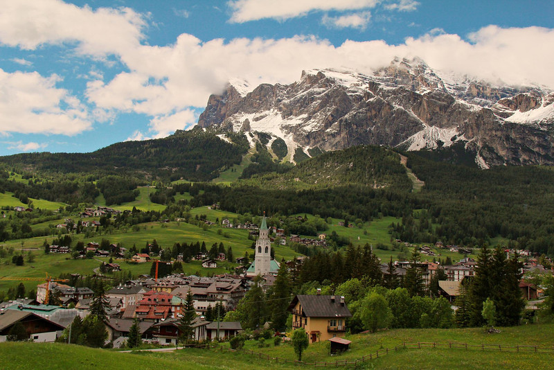 Groomed ski slopes can be seen in the mountains behind Cortina d'Empezzo, Italy.