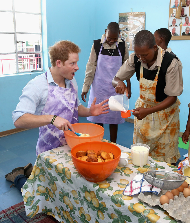 . Prince Harry cooks with children during a visit to the Thuso Centre for children living with multiple disabilities on December 7, 2014 in Bute-Bute, Lesotho.  (Photo by Chris Jackson/Getty Images for Sentebale)