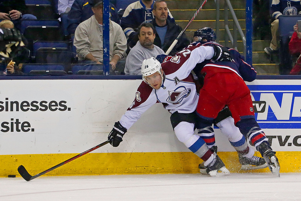 . COLUMBUS, OH - APRIL 1:  Mark Letestu #55 of the Columbus Blue Jackets checks Paul Stastny #26 of the Colorado Avalanche while chasing after the puck during the second period on April 1, 2014 at Nationwide Arena in Columbus, Ohio. (Photo by Kirk Irwin/Getty Images)