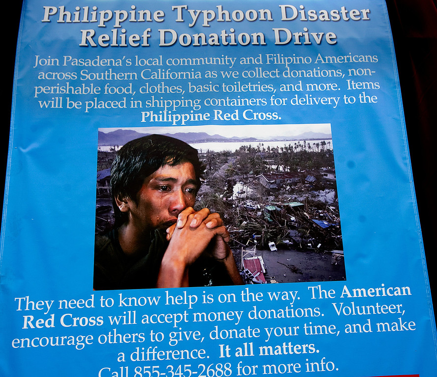 . A poster at the Rose Bowl for the  Philippine Typhoon Relief Donation Drive. PCC along with Vice Mayor Jacque Robinson, the American Red Cross, Filipino American Television, Victory Cargo, and the PNB-Remittance Centers  sponsoring a Philippine Typhoon Relief Donation Drive Donation Drive Drop-Off Rally Wednesday, November 20, 2013 at the Rose Bowl. (Photo by Walt Mancini/Pasadena Star-News)