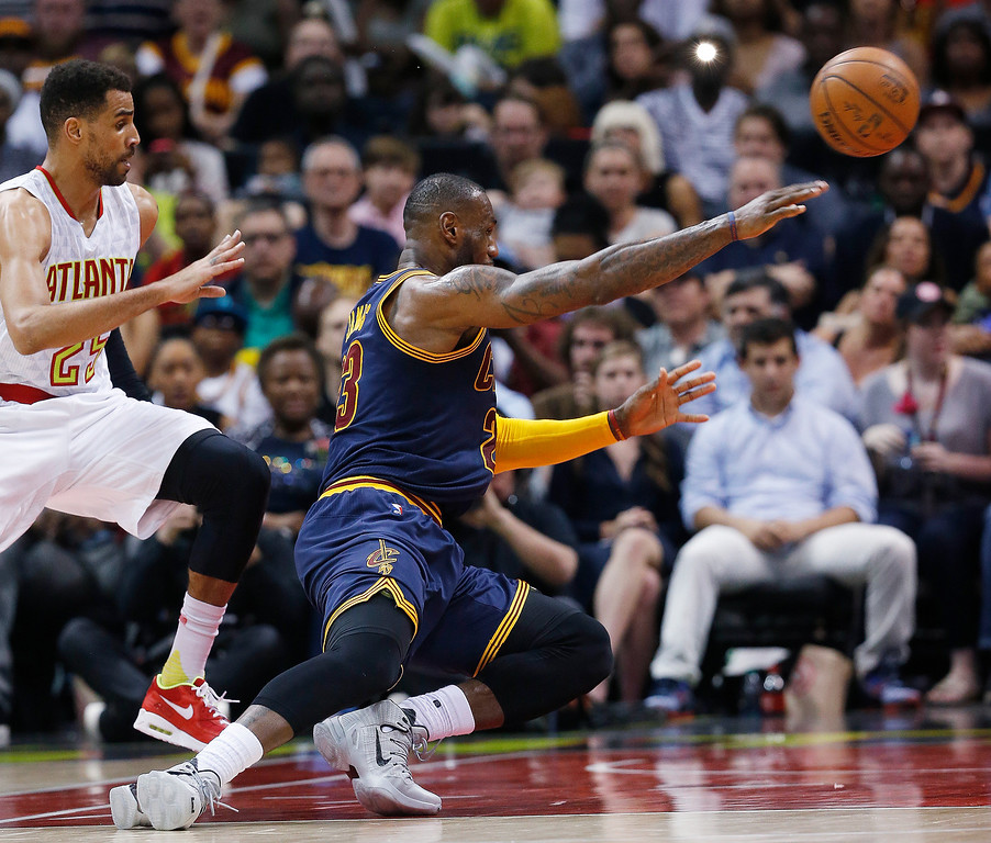 . Cleveland Cavaliers forward LeBron James (23) falls to the court after making a pass against Atlanta Hawks forward Thabo Sefolosha (25) in the first half  of Game 4 of the second-round NBA basketball playoff series, Sunday, May 8, 2016, in Atlanta. (AP Photo/John Bazemore)