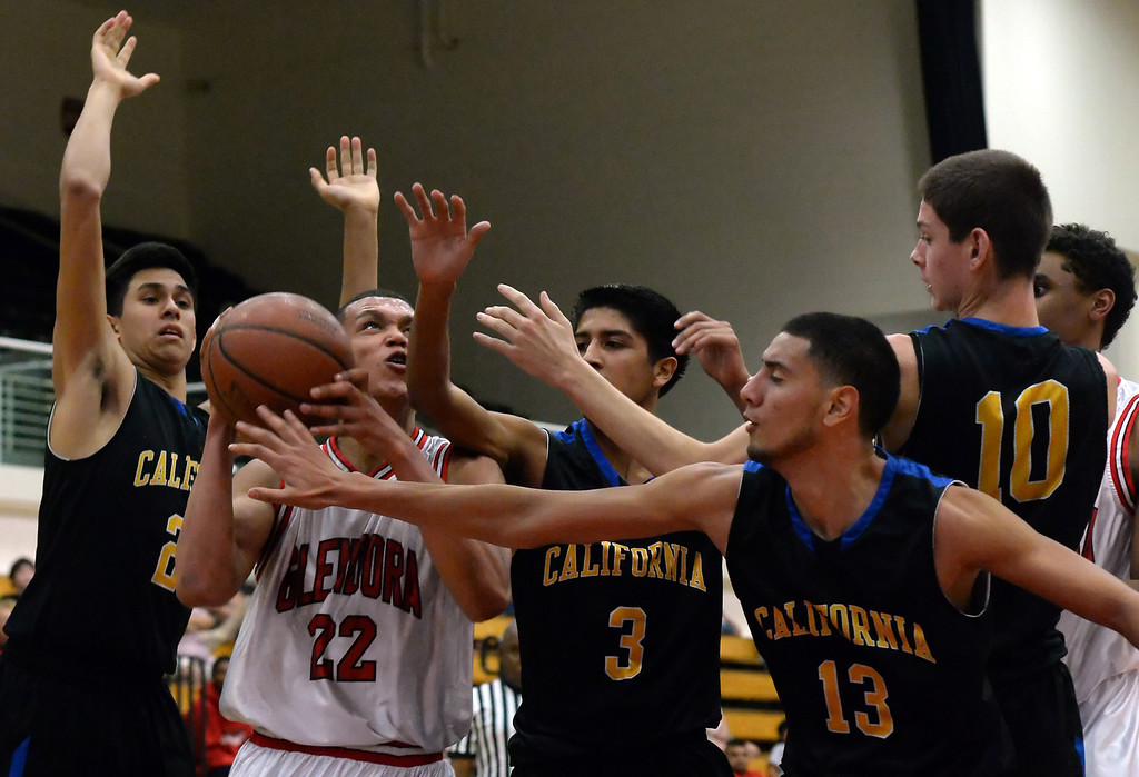 . Glendora\'s Brandon Brothers (22) drives to the basket between California\'s Isaiah Martinez (2) Brandon Suarez (3), Carlos Legaspy (13) and Brady Gravitt (10) in the first half of a prep basketball game during the SoCal Shootout in the Felix Event Center on the west campus of Azusa Pacific University in Azusa, Calif., on Saturday, Jan. 18, 2014. (Keith Birmingham Pasadena Star-News)