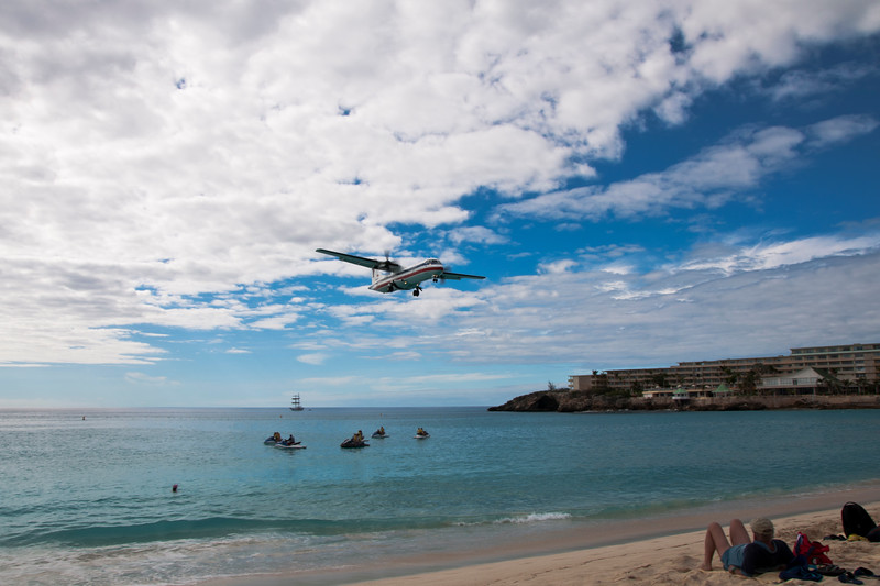 Beach goers await the arrival of planes at the airport near Maho beach.