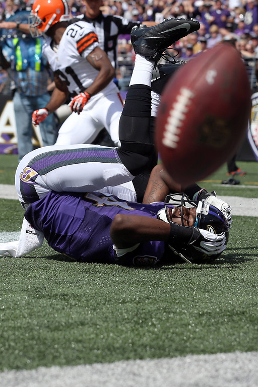 . Wide receiver Marlon Brown #14 of the Baltimore Ravens bobbles a catch in the end zone during the first quarter against the Cleveland Browns at M&T Bank Stadium on September 15, 2013 in Baltimore, Maryland.  (Photo by Rob Carr/Getty Images)