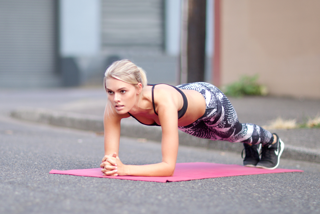 plank on yoga mat in the street