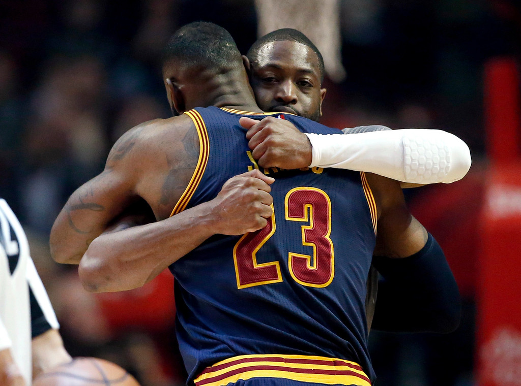 . Chicago Bulls guard Dwyane Wade, rear, hugs Cleveland Cavaliers forward LeBron James before an NBA basketball game Friday, Dec. 2, 2016, in Chicago. (AP Photo/Nam Y. Huh)
