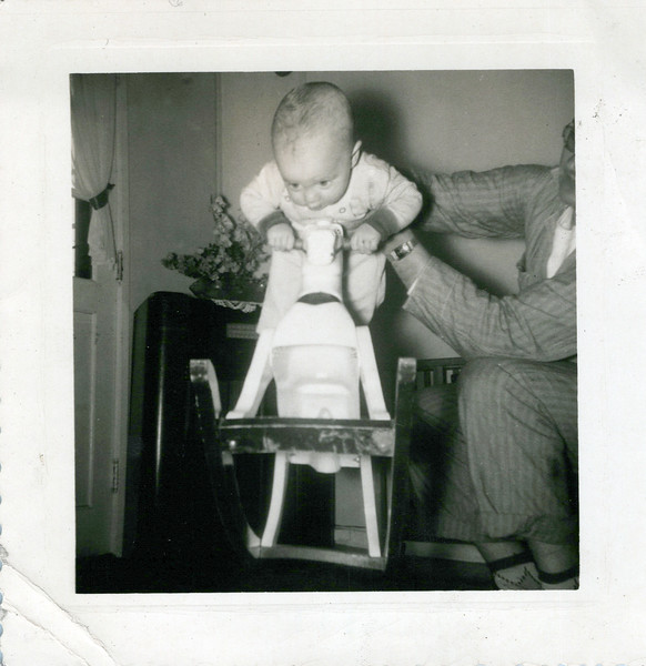 1952 Ken just barely on a rocking horse.jpeg