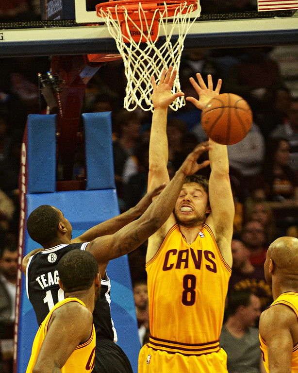 . Michael Allen Blair/Digital First Media Cavs\' guard Matthew Dellavedova defends the basket from the Nets\' Marquis Teague during the second quarter of a game April 16 at Quicken Loans Arena.