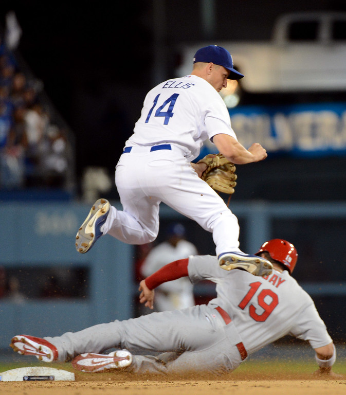 . Los Angeles Dodgers\' Mark Ellis throws to first in a double play as St. Louis Cardinals\' Jon Jay attempts to slide to second in the sixth during the NLCS at Dodger Stadium Tuesday, October 15, 2013. (Photo by David Crane/Los Angeles Daily News)