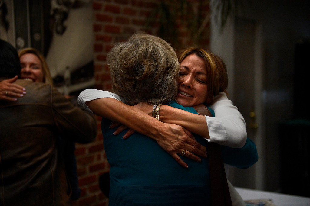 . DENVER, CO. - APRIL 30:  Sandra Hirota is hugged by Tammy Cunningham, owner of Strings Restaurant during an auction of the restaurants art work after the last day of service April 30, 2013 Denver, Colorado. (Photo By Joe Amon/The Denver Post)