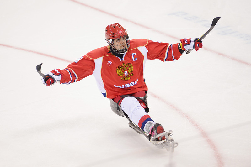 . Dmitrii Lisov of Russia celebrates after scoring a penalty during the Ice Sledge Hockey Preliminary Round Group A match between the Russia and Korea at Shayba Arena on March 8, 2014 in Sochi, Russia.  (Photo by Dennis Grombkowski/Getty Images)