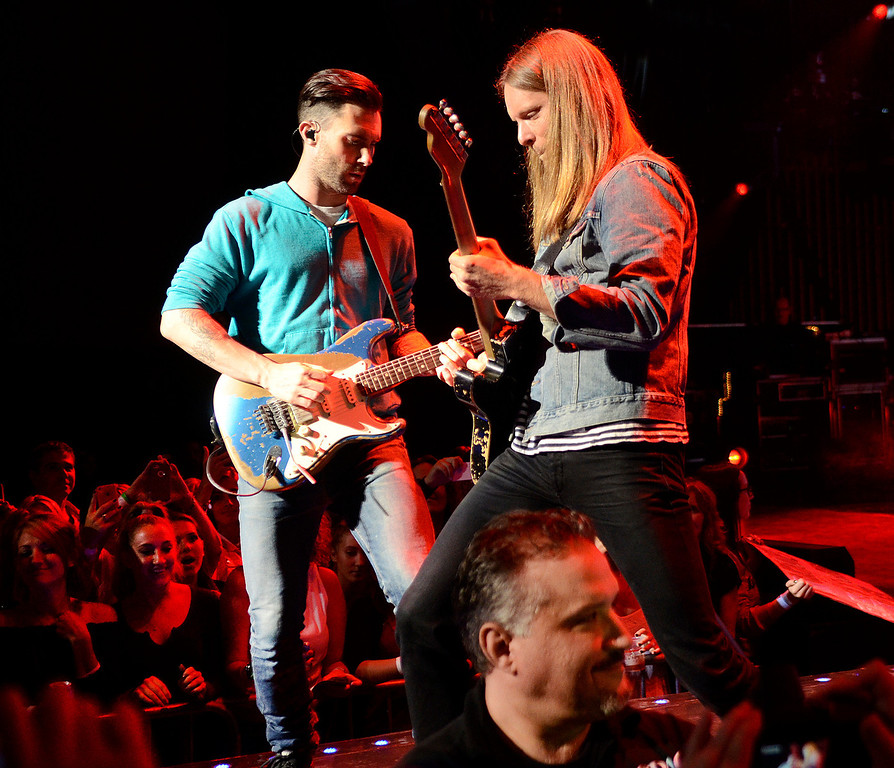 . Adam Levine, left, and James Valentine as Maroon 5 takes the stage Thursday at SPAC. Photo Ed Burke/SARATOGIAN 9/5/13