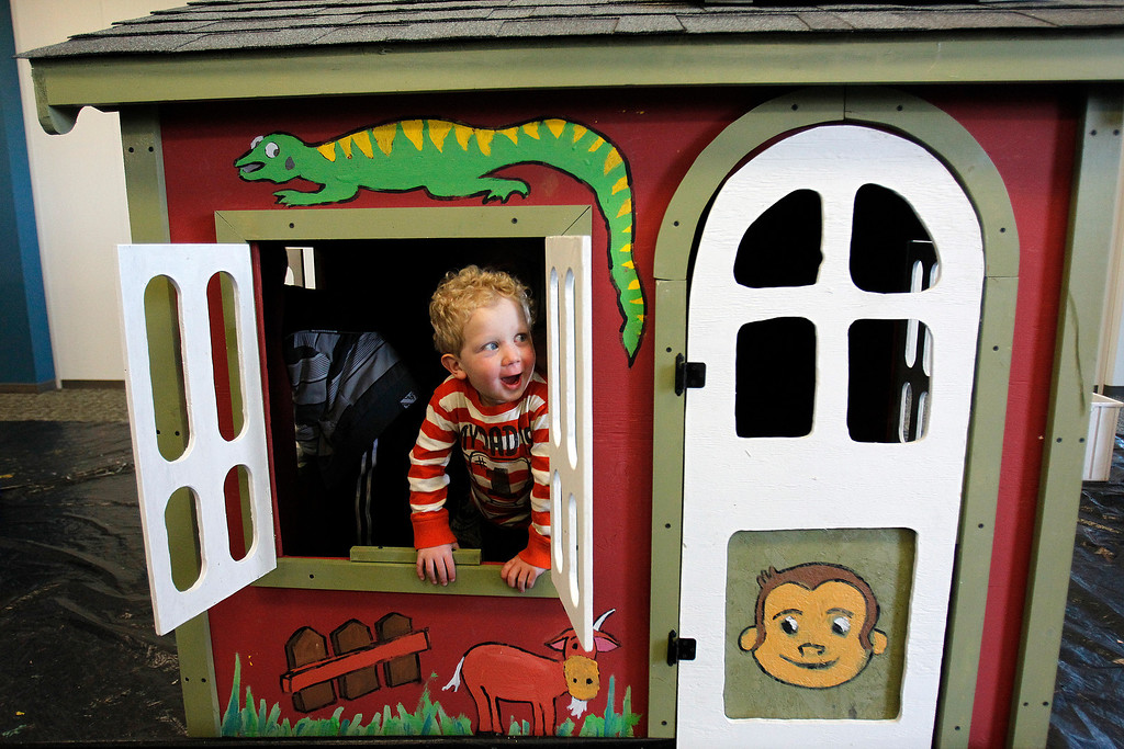 . Max Shearer, 2, checks out his new playhouse that was built by NetScout Systems employees and Habitat for Humanity volunteers at the NetScout offices in San Jose, Calif. on Thursday, Feb. 21, 2013.   (LiPo Ching/Staff)