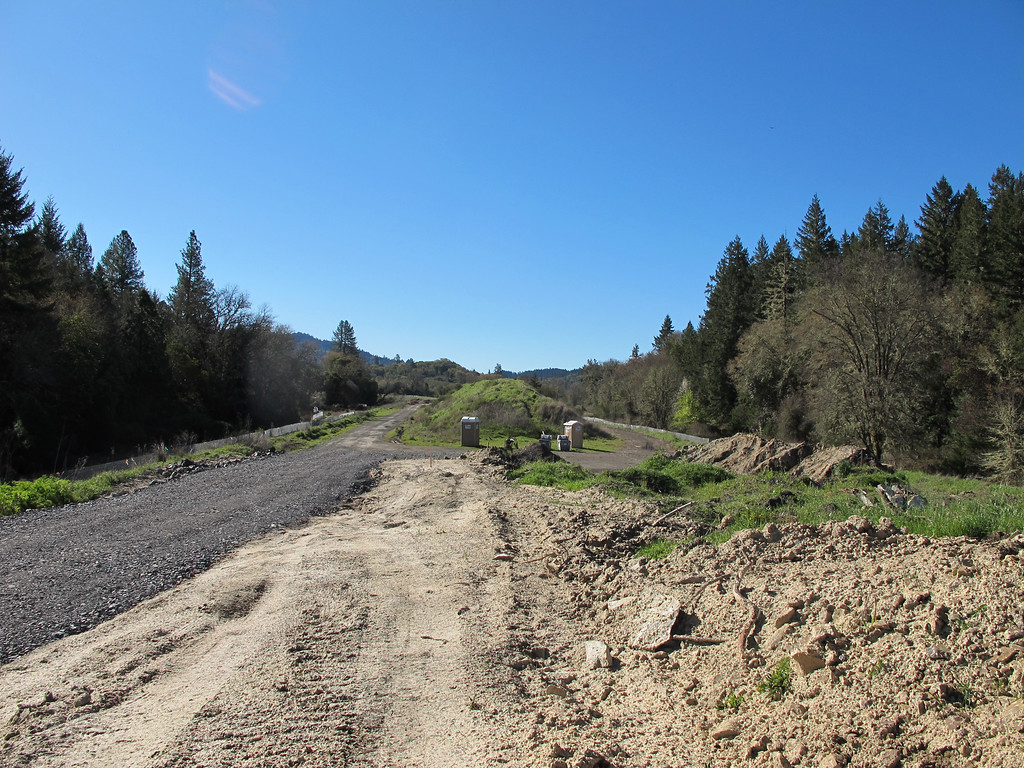 . Looking south toward the Warbler tree. CalTrans has been accumulating mounds of fill at this location for years along the bypass route on the ranch road in anticipation of the bypass. The new gravel to the east was placed by CalTrans so the CHP tree extraction manlifts could travel to the site of tree sitters two and three.