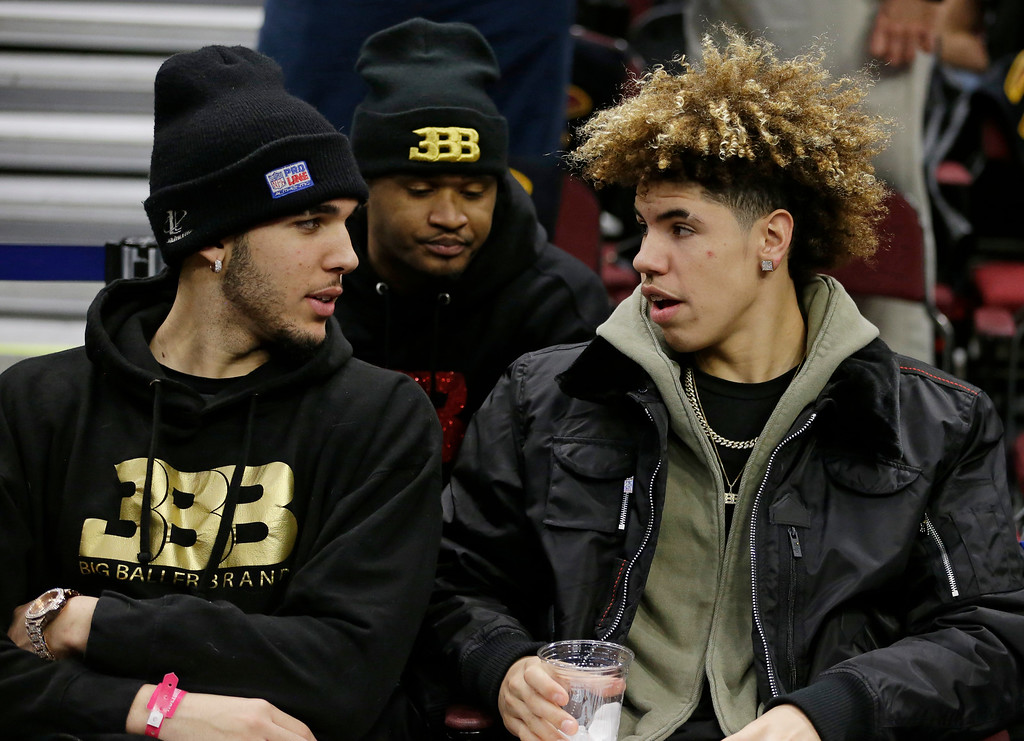 . LiAngelo Ball, left, and his brother, LaMelo, talk before an NBA basketball game between the Los Angeles Lakers and the Cleveland Cavaliers, Thursday, Dec. 14, 2017, in Cleveland. (AP Photo/Tony Dejak)