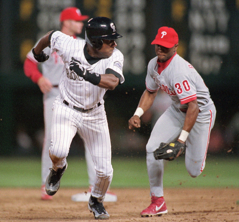 . Colorado Rockies\' Darryl Hamilton, left, tries to elude Philadelphia Phillies shortstop Desi Relaford in a rundown between second and third bases in the third inning in Denver\'s Coors Field on Saturday, Aug. 15, 1998. Relaford managed to put out Hamilton. (AP Photo/David Zalubowski)