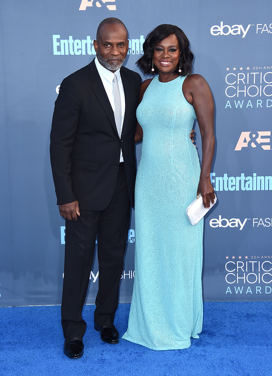 . Viola Davis, right, and Julius Tennon arrive at the 22nd annual Critics\' Choice Awards at the Barker Hangar on Sunday, Dec. 11, 2016, in Santa Monica, Calif. (Photo by Jordan Strauss/Invision/AP)