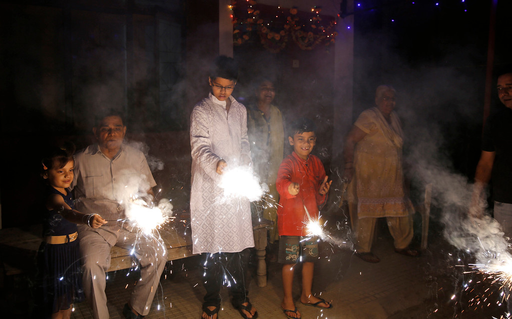 . Indian children play with firecrackers to celebrate Diwali, the Hindu festival of lights, in Allahabad, India, Thursday, Oct. 19, 2017. Hindus light lamps, wear new clothes, exchange sweets and gifts and pray to goddess Lakshmi during Diwali, the festival of lights. (AP Photo/Rajesh Kumar Singh)