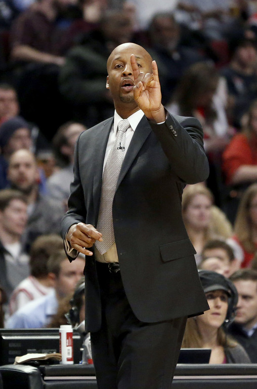 . Denver Nuggets head coach Brian Shaw directs his team during the first half of an NBA basketball game against the Chicago Bulls, Friday, Feb. 21, 2014, in Chicago. The Bulls won 117-89. (AP Photo/Charles Rex Arbogast)