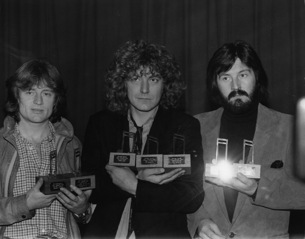 . 28th November 1979:  Three members of rock group Led Zeppelin with their seven Melody Maker awards. They are, from left to right John Paul Jones (bass, keyboards), Robert Plant (vocals) and John Bonham (1947 - 1980) (drums).  (Photo by Keystone/Getty Images)