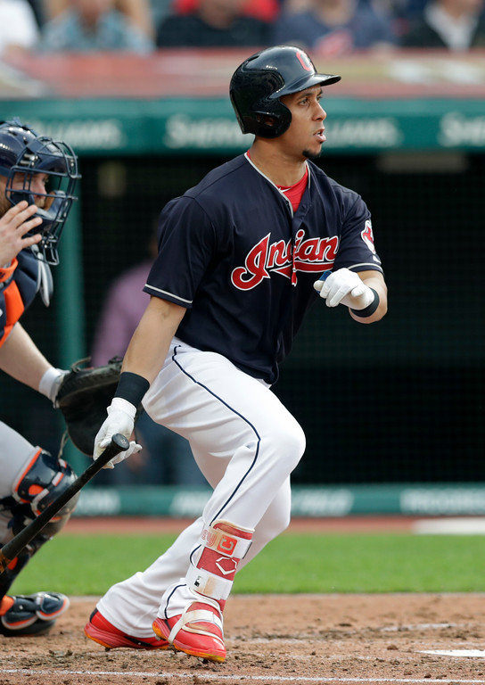 . Cleveland Indians\' Michael Brantley watches his ball after hitting a two-run single off Houston Astros starting pitcher Charlie Morton in the third inning of a baseball game, Thursday, May 24, 2018, in Cleveland. Roberto Perez and Francisco Lindor scored on the play. (AP Photo/Tony Dejak)