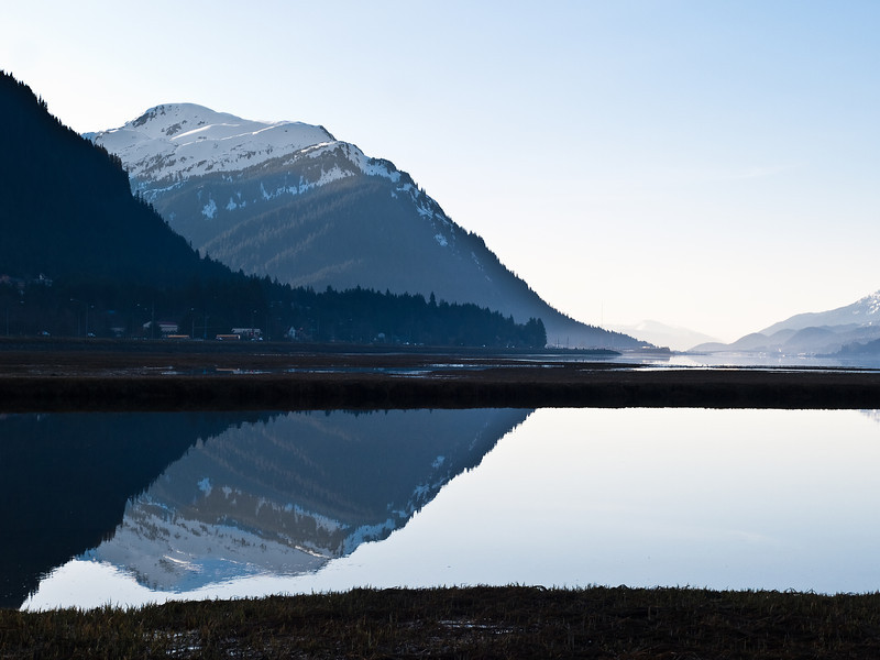 The back side of Mount Juneau can be seen reflected in Lemon Creek, midway between the Mendenhall Valley and downtown Juneau. April 30th, 2009.